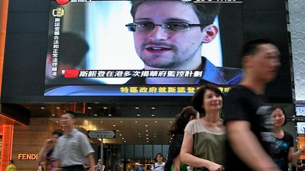 A TV screen in Hong Kong shows a news report about Edward Snowden on Sunday, the day he left for Russia.