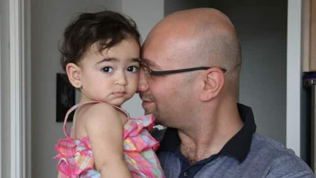 Thamer Khirdaji, pictured here with his daughter Julie, has been following the conflict back home in Syria closely. He is currently waiting to hear whether his work permit in Canada will be extended. If not, he may have to return to Syria.