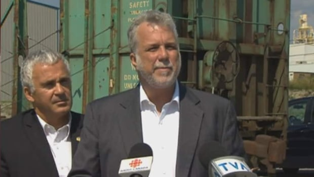 Quebec Liberal leader Phillippe Couillard called for the quick reopening of rail service to Lac-Mégantic, Que. on a visit with Mégantic Liberal MNA, Ghislain Bolduc.