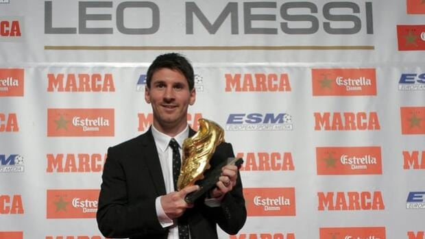 Lionel Messi poses for photographers upon receiving the 2012 Golden Boot Award on Monday.
