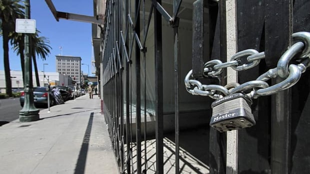 Shuttered and padlocked businesses line Main Street in Stockton, Calif. The city will soon become the largest to file for Chapter 11 bankruptcy protection.