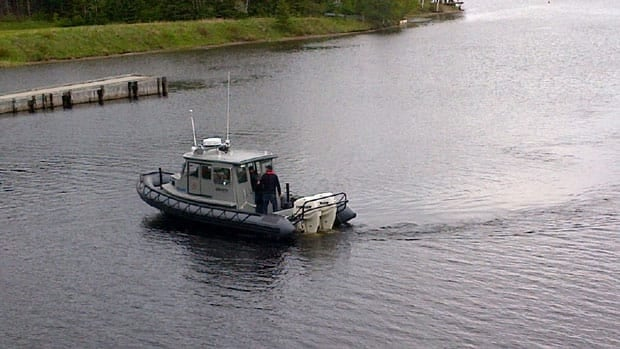 Police search the Mira River in Nova Scotia Saturday.