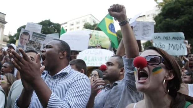 Demonstrators shout anti-government slogans during a protest in Rio de Janeiro, one of many such protests in Brazil's major cities on Thursday.