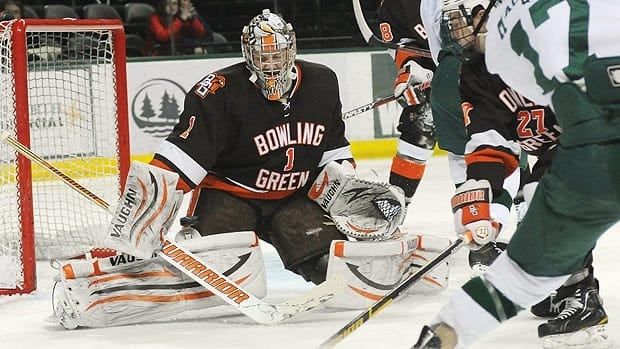 Goalie Andrew Hammond makes a save for Bowling Green during a 2011-12 season game.