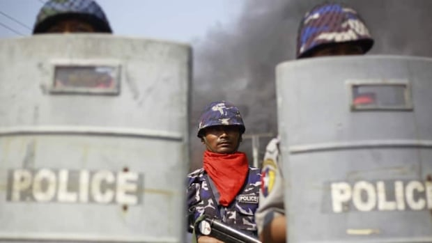 Policemen are deployed to provide security amid riots in Meikhtila last week. Unrest between Buddhists and Muslims in central Burma has reduced neighbourhoods to ashes and stoked fears that last year's sectarian bloodshed is spreading into the country's heartland.