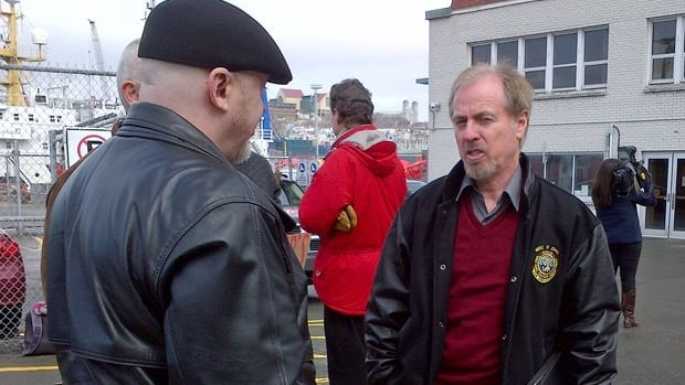 Merv Wiseman (facing camera) was reprimanded for an unauthorized visit by a Liberal MHA to the local search and rescue sub-centre.