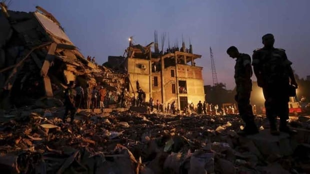 Soldiers stand in the rubble at the site of a building that collapsed in Savar, Bangladesh, near Dhaka, on April 24. Inspectors are accused of failing to actually inspect the building.