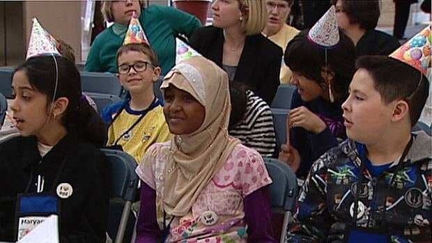 Students help launch Edmonton Public Library's 100th anniversary celebrations at city hall Tuesday.