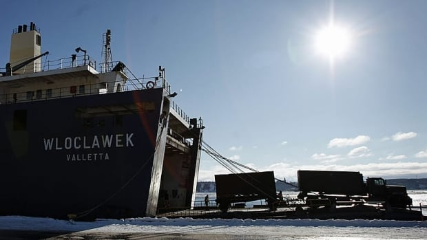 An uptick in crude oil exports helped narrow Canada's trade deficit with the rest of the world.