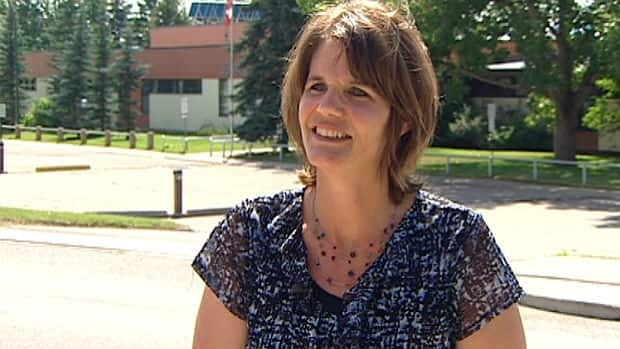 Brenda Samborski says a proposed wind turbine across the street at Cochrane High School does not belong there.