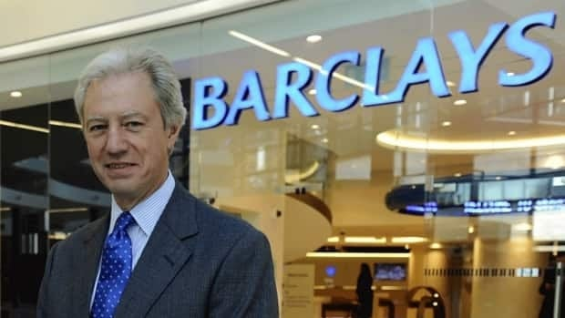 Barclays chairman Marcus Agius poses at a bank branch in London in September 2010. Agius resigned Monday after it emerged that employees of the British bank submitted false data on interbank borrowing rates. U.K. authorities are considering laying criminal charges against the bank on top of the $453 million US in fines from British and U.S. agencies the bank already faces.