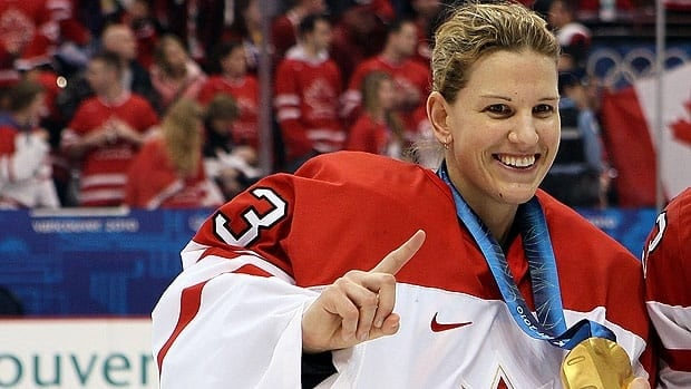 Kim St.Pierre poses with her third Olympic gold medal in 2010 in Vancouver.