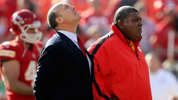 Kansas City Chiefs general manager Scott Pioli, left, and coach Romeo Crennel stand together before the game against the Carolina Panthers on Sunday in Kansas City, Mo.
