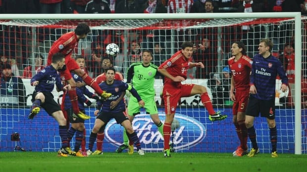 Laurent Koscielny of Arsenal heads his squad's second goal during the UEFA Champions League Round of 16 second leg match between Bayern Munich and Arsenal at Allianz Arena on Wednesday in Munich, Germany.