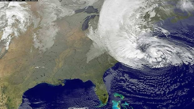 Hurricane Sandy is seen on the East Coast of the United States in this NASA satellite image taken at 3:55 a.m. ET Tuesday. Astronauts aboard the International Space Station could watch the storm advance.