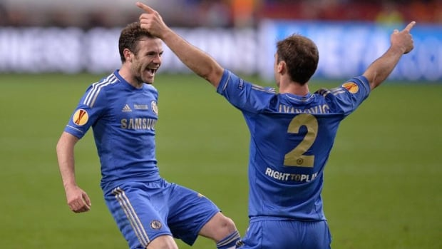 Chelsea's Juan Mata, left, and Branislav Ivanovic, celebrate at the end of the Europa League final soccer match against Benfica in Amsterdam, Netherlands on Wednesday. Chelsea defeated Benfica 2-1.