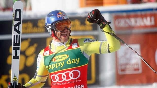 Aksel Lund Svindal, of Norway, celebrates his first place finish in the men's World Cup Super-G in Lake Louise, Alta., on Sunday.