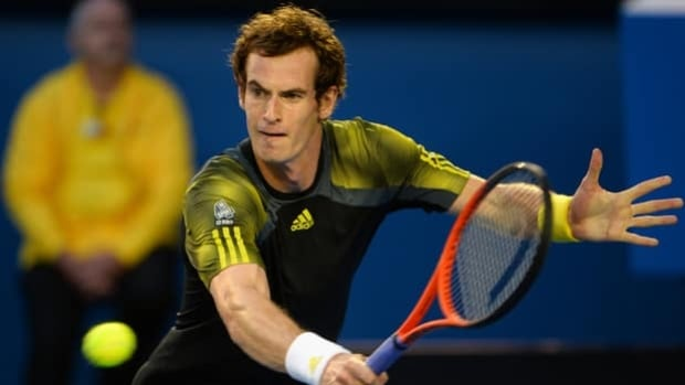 Andy Murray hits a backhand return in a five-set semifinal win over Roger Federer on Friday.
