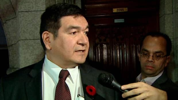 Intergovernmental Affairs Minister Peter Penashue speaks with reporters on Nov. 6 outside the House of Commons.