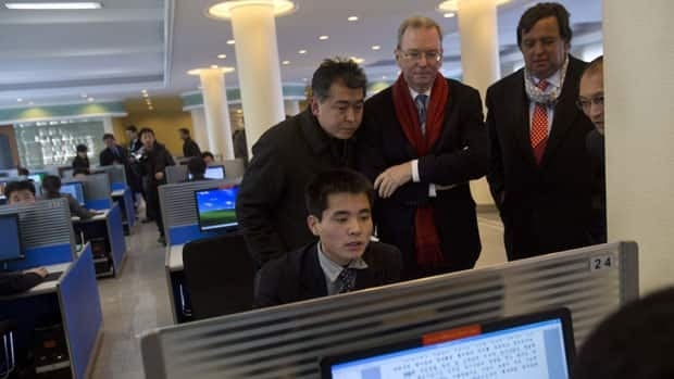 Executive chairman of Google, Eric Schmidt, third from left, and former New Mexico governor Bill Richardson, second from right, watch as a North Korean student surfs the internet at Kim Il Sung University in Pyongyang, North Korea, on Tuesday.