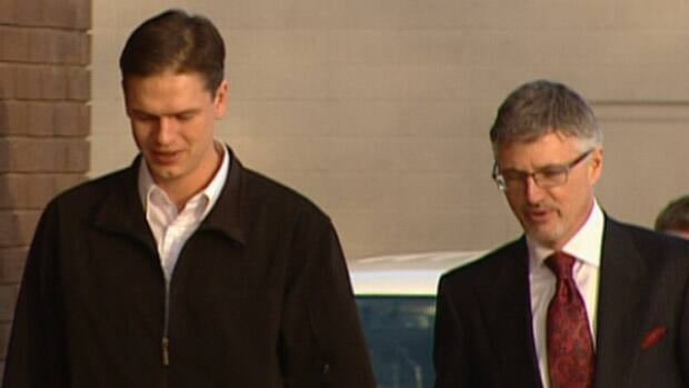 Justin Frank, left, enters the Leduc provincial court building with lawyer Rick Muenz on Monday.