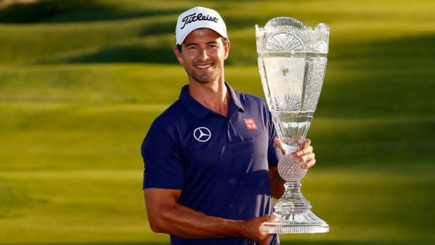 Adam Scott poses with the trophy after winning The Barclays at Liberty National Golf Club on August 25, 2013 in New Jersey.