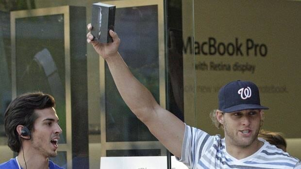 Brock Westphal holds up his new iPhone 5 outside an Apple Store in Salt Lake City on Friday. Apple was unable to meet demand for the phone in the first three days of sales.