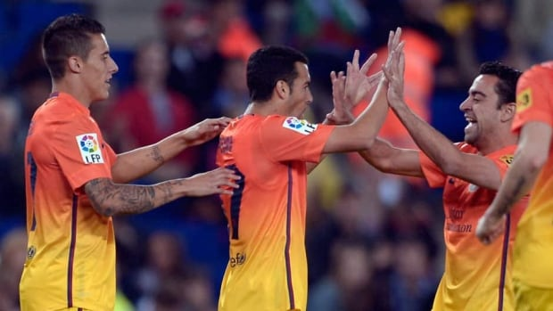 FC Barcelona's Pedro Rodriguez, centre, is congratulated by his teammates after he scored against Espanyol at Cornella-El Prat stadium in Cornella Llobregat, Spain on Sunday.