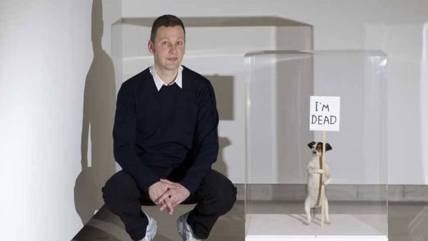 David Shrigley poses next to taxidermied Jack Russell I'm Dead (2010) in his first major U.K. exhibition. He is nominated for the Turner Prize.