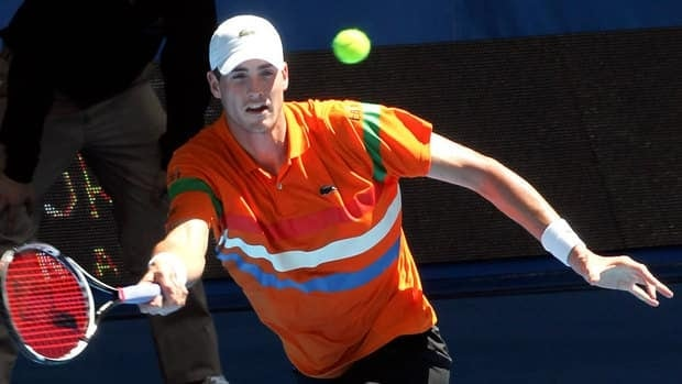 John Isner hits a return against Kevin Anderson during their third session men's singles match on day two of the Hopman Cup tennis tournament Monday.