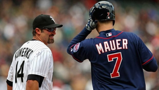 Even divisional rivals like the White Sox' Paul Konerko, left, and the Twins' Joe Mauer will strike up a conversation upon meeting at first base.