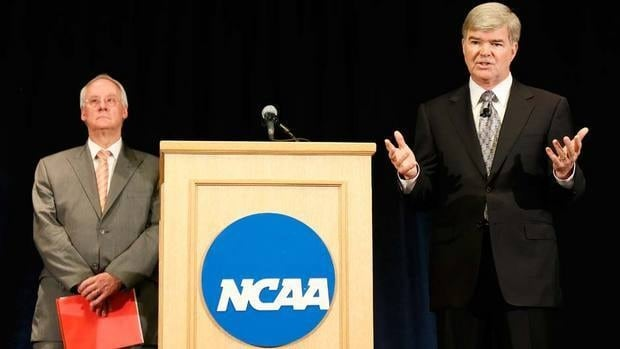 NCAA president Mark Emmert, right, speaks as Ed Ray, chairman of the NCAA's executive committee and Oregon State president looks on, during a press conference at the NCAA's headquarters to announce sanctions against Penn State University's football program on July 23.