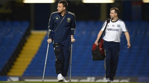 Chelsea captain John Terry, left, required crutches upon injuring his right knee on Nov. 11.