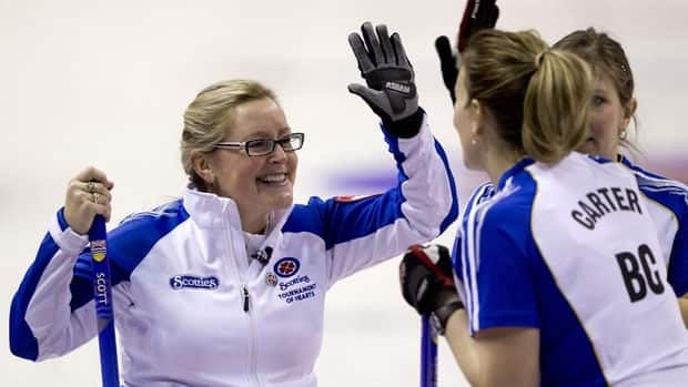 British Columbia skip Kelly Scott, left, high fives teammate Sasha Carter during the playoff game against Manitoba at the Scotties Tournament of Hearts.