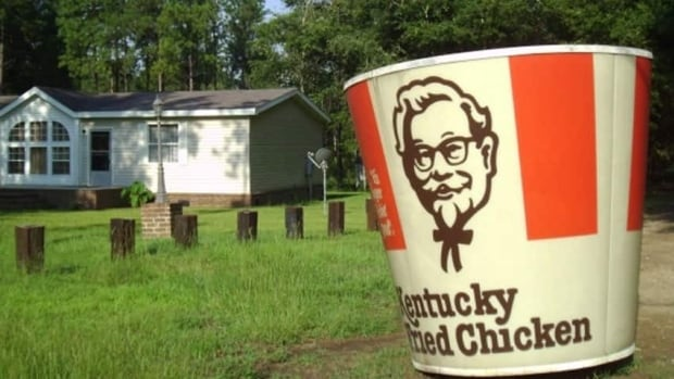 Aleena Headrick is learning to live with her new lawn ornament — a two-metre-tall Kentucky Fried Chicken bucket.