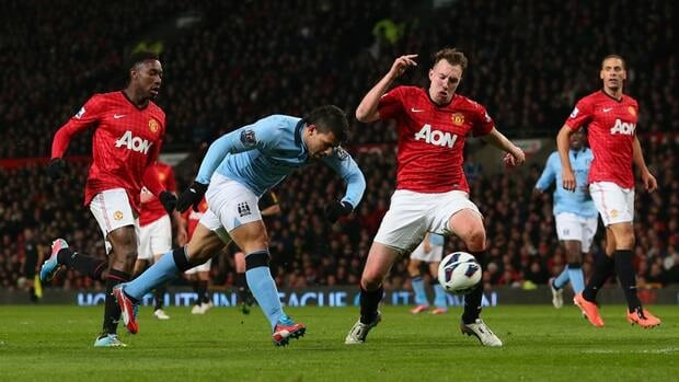 Sergio Aguero of Manchester City scores his team's second goal against Manchester United at Old Trafford on Monday.