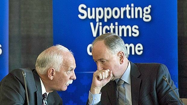 Public Safety Minister Vic Toews (left) and Justice Minister Rob Nicholson consult on a victims bill of rights earlier this week.