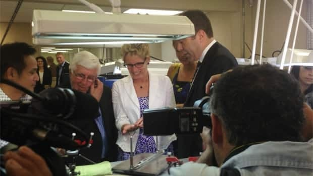 The premier inspects Canada's largest diamond, alongside Sudbury MPP Rick Bartolucci. The diamond was discovered earlier this year in Ontario's Victor Mine.