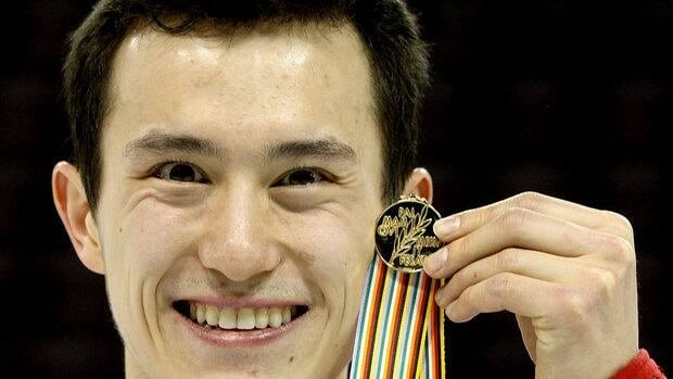 Patrick Chan poses with the gold medal after winning the Men's Competition during the ISU Four Continents Figure Skating Championships at World Arena on February 10, 2012 in Colorado Springs, Colorado.