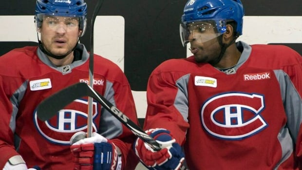 Andrei Markov and PK Subban go over a play at yesterday's practice.