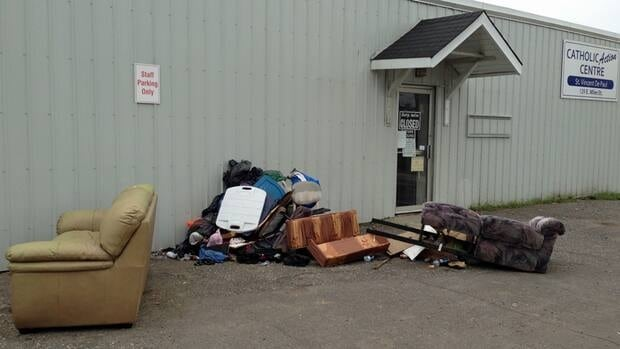 Donations sit outside a temporarily closed second-hand store in Thunder Bay.