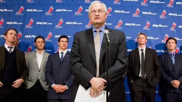 NHLPA executive director Donald Fehr, centre, maintains the players and league have agreements on almost all of the important issues.