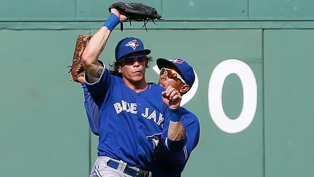 Colby Rasmus, left, and Anthony Gose nearly collided on this play, but Toronto would prevail at Fenway.