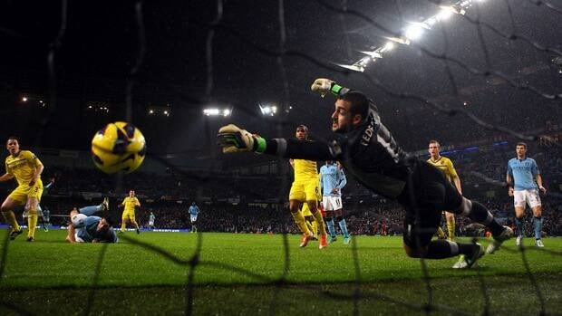 Gareth Barry of Manchester City scores a header past Adam Federici of Reading during the match at Etihad Stadium in Manchester, England.