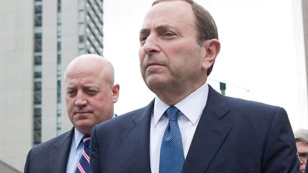 The NHL, represented in labour talks by commmissioner Gary Bettman, right, and deputy commissioner Bill Daly, left, has proposed changes to unrestricted free agency, entry-level deals, arbitration and contract lengths.