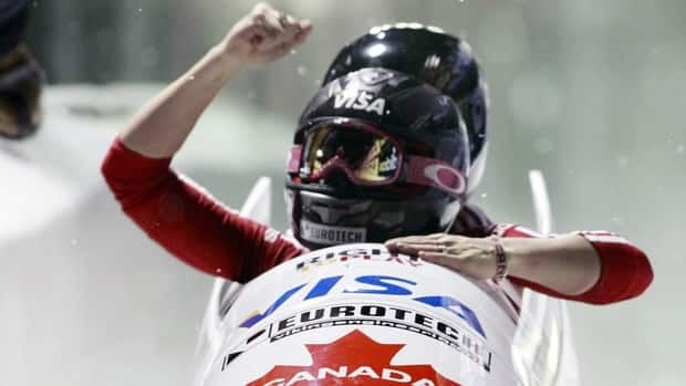 Canada's Kaillie Humphries, front, reacts with teammate Jennifer Ciochetti after winning the women's bobsled world championships on Saturday.