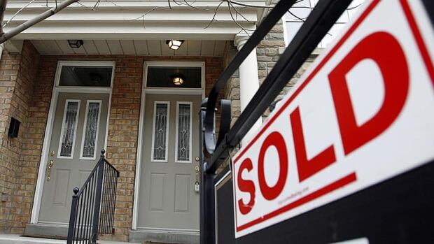 Canadian home prices inched slightly lower in June, down 0.8 per cent from last year's level.