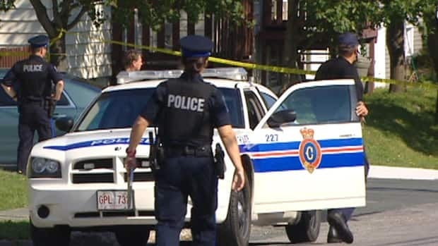 A large number of police officers shut down a residential street in St. John's where an illegal drug lab was discovered.