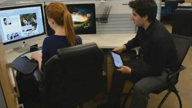 Bell promotes its Professional Management Program with images like this, showing interns gaining from the experience.