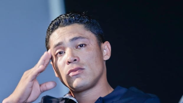 San Diego Padres shortstop Everth Cabrera, who was suspended by Major League Baseball for 50 games, speaks to the media after breaking down during a news conference in San Diego on Monday.